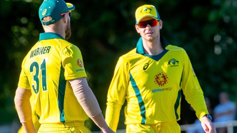 Australia's Steve Smith (R) and Australia's David Warner speak during the second of three warm-up cricket matches.