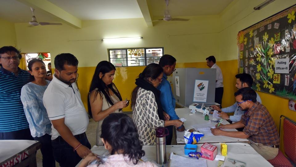 Voters at a polling station in Greater Kailash, under New Delhi parliamentary constituency, during the sixth phase of Lok Sabha elections, Sunday, May 12, 2019.