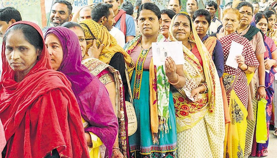 Votera queue up outside a polling booth in Bhopal on May 12, the sixth phase in the seven-phase LokSabha elections 2019