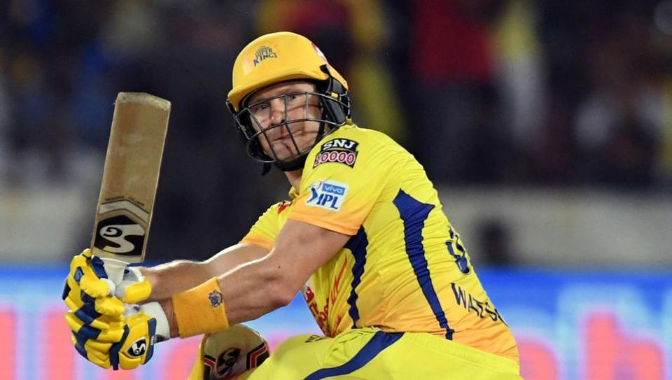 (FILES) In this file photo taken on May 12, 2019 Chennai Super Kings cricketer Shane Watson (L) plays a shot -- with blood staining his uniform behind his pads on his left knee