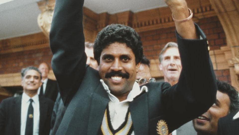 India captain Kapil Dev lifts the trophy on the balcony of the pavillion as Sunil Gavaskar (obscured right) looks on after the 1983 Prudential World Cup Final victory against West Indies at Lords on June 23, 1983 in London, England. (Getty Images)