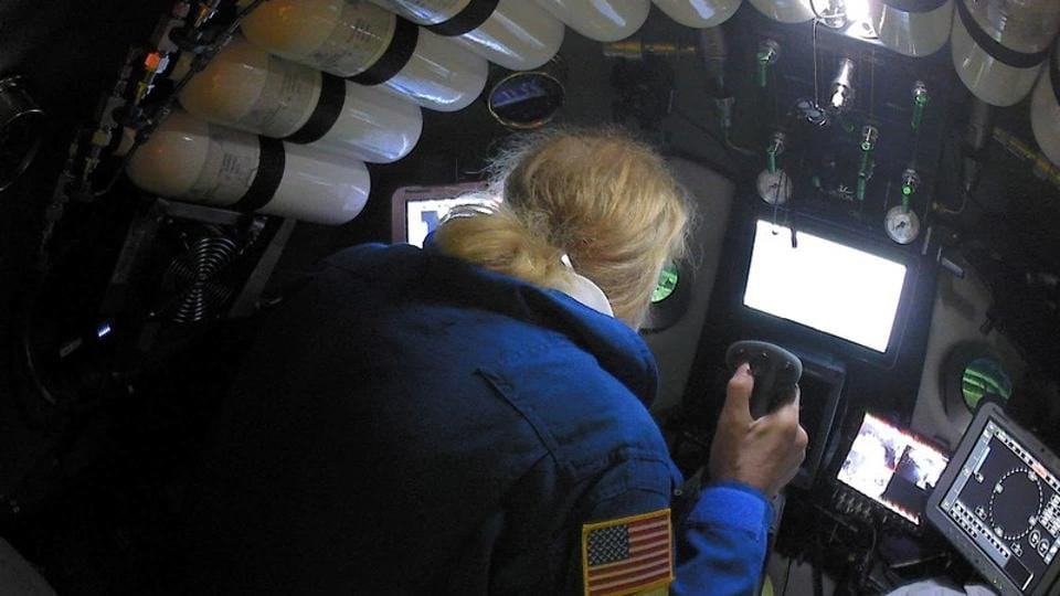 Undersea explorer Victor Vescovo pilots the submarine DSV Limiting Factor in the Pacific Ocean's Mariana Trench in an undated still image from video released by the Discovery Channel May 13, 2019.