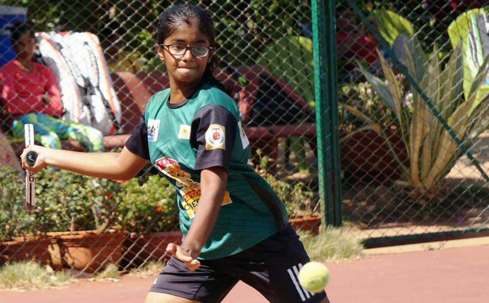 City player Aditi Lakhe in action at the MSLTA Yonex Sunrise Hotel Ravine under-14 national ranking tennis tournament at Ravine hotel courts on Tuesday.