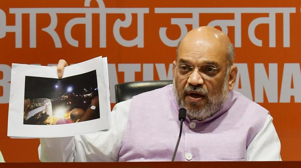 "BJP chief Amit Shah accused the Trinamool Congress of orchestrating violence during his roadshow in Kolkata, presenting photographs to prove his point as the TMC, BJP sparring intensified in the slog overs of the Lok Sabha elections. ""We will not be intimidated by violence… Anger of Bengalis will translate into defeat for Mamata didi who is stifling democracy in the state,"" the BJP chief said. (Raj K Raj / HT Photo)"