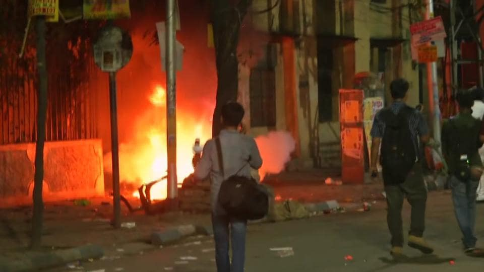Fire breaks as violence reported between supporters during the road show of BJP President Amit Shah in Kolkata on Tuesday.