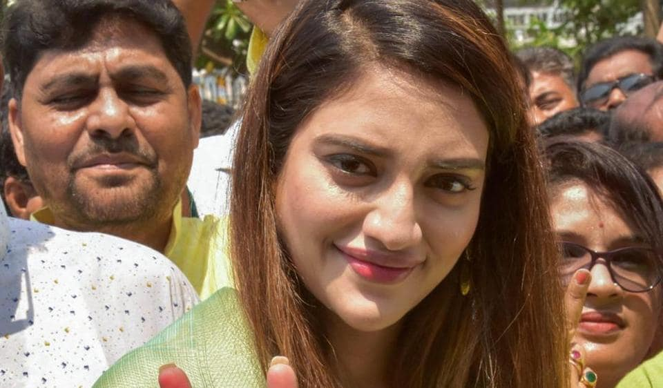 North 24 Parganas: Bengali film actress and TMC candidate for Basirhut parliamentary seat, Nusrat Jahan, shows the victory sign before filing her nomination papers at Barasat in North 24 Parganas district.