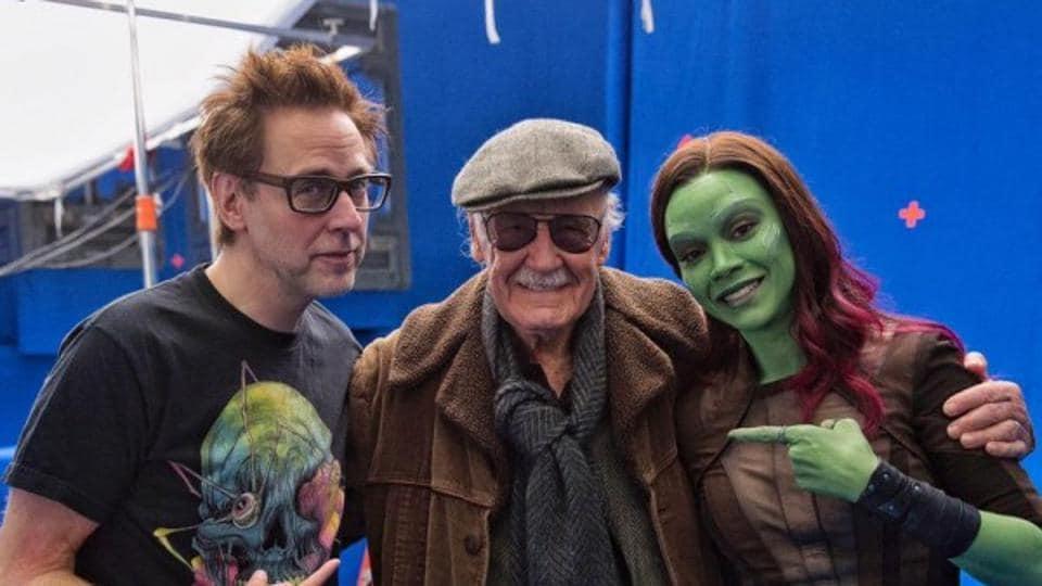 James Gunn poses with the late Stan Lee and Zoe Saldana.