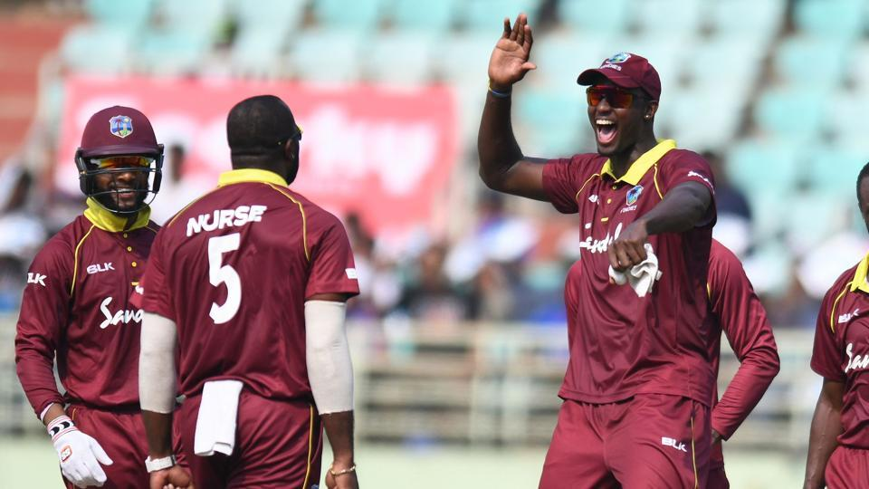 Representative image -  File image of Windies cricketer Jason Holder celebrates with his teammates after a wicket.