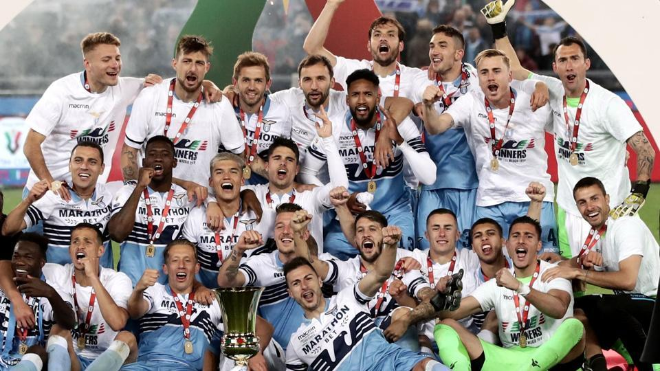 Lazio's team players and members of staff celebrate during the trophy ceremony after winning the Italian Tim Cup final.