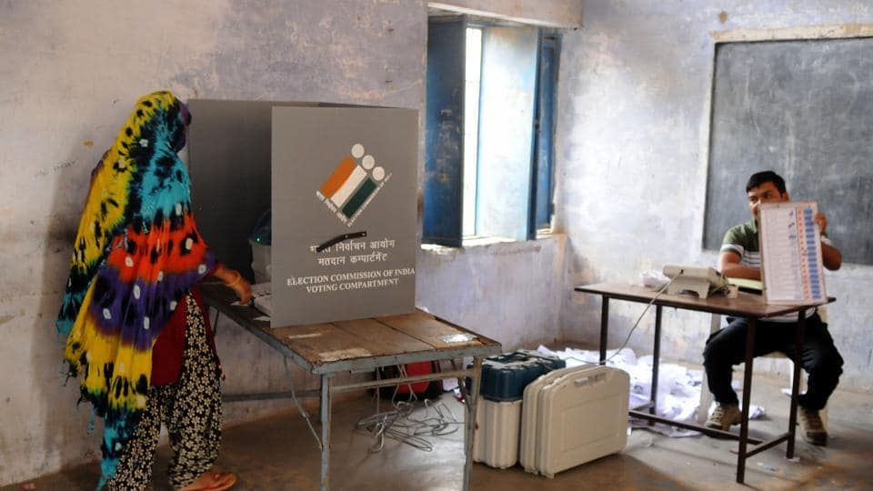 A woman voter casts her vote at a polling booth, Gurugram, May 12, 2019