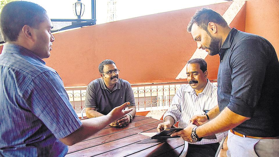 Rony george(left) founder director of NGO Chaitanya Mental Helath Institute interacting with staff members at the South East Cafe in Koregaon Park.