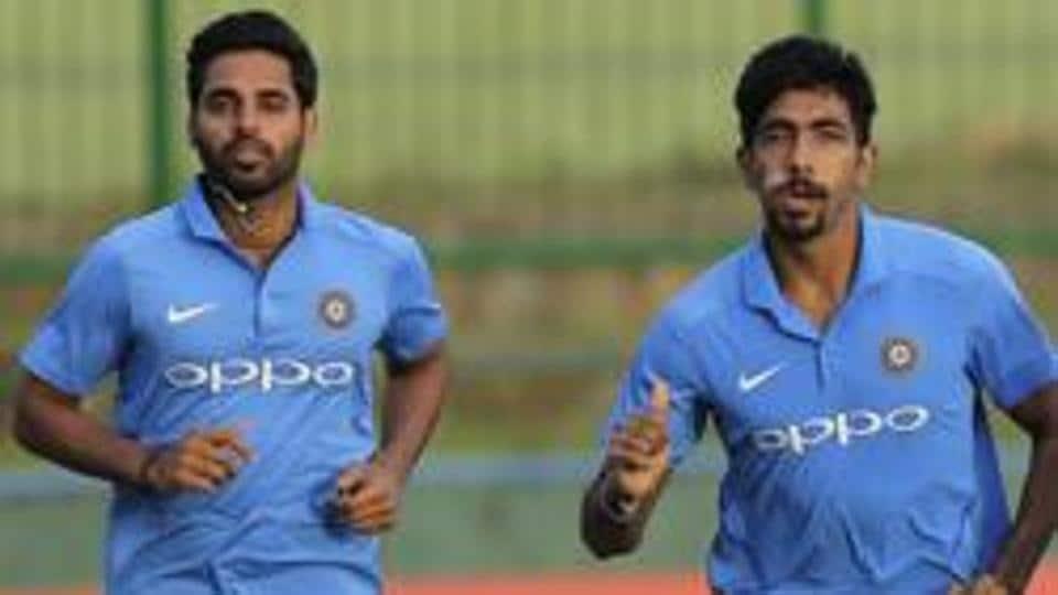 Indian cricketers Bhuvneshwar Kumar (L) and Jasprit Bumrah.