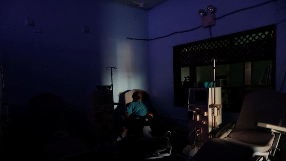 """William Lopez, 45, a patient with kidney disease, waits for the electricity to return, at a dialysis centre, during a blackout in Maracaibo, Venezuela.  Like any chronic kidney patient, he could die if he goes too long without treatment. """"The impotence that I feel makes me want to cry,"""" said Lopez, 45, one of 11,000 Venezuelans whose dialysis treatment has been thrown into disarray by a wave of blackouts in the oil-rich but crisis-stricken South American country. (Ueslei Marcelino / REUTERS)"""