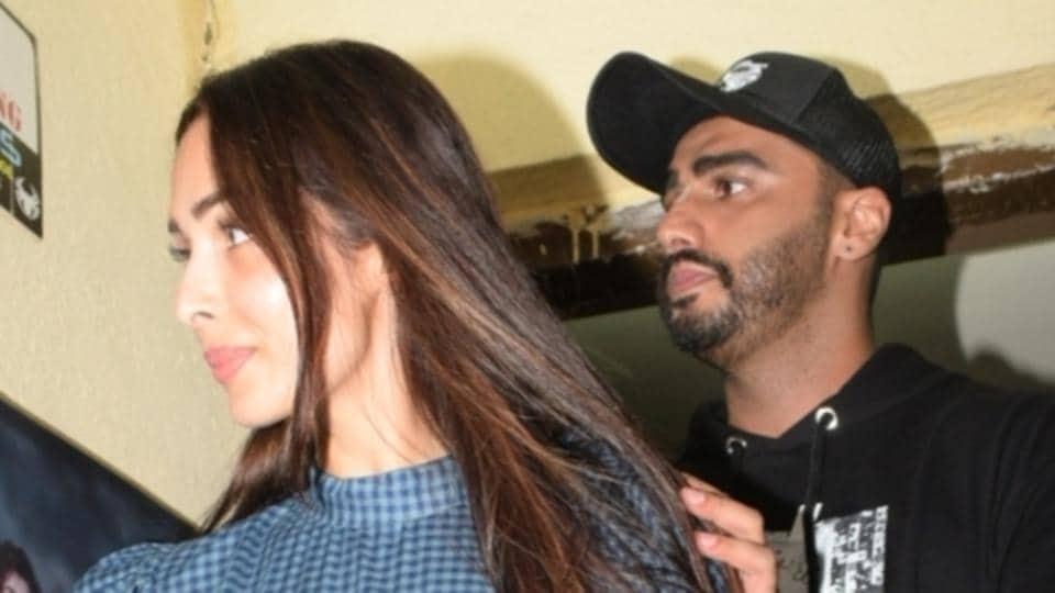Actor Arjun Kapoor with his actor Malaika Arora, at the screening of his upcoming film India's Most Wanted in Mumbai.