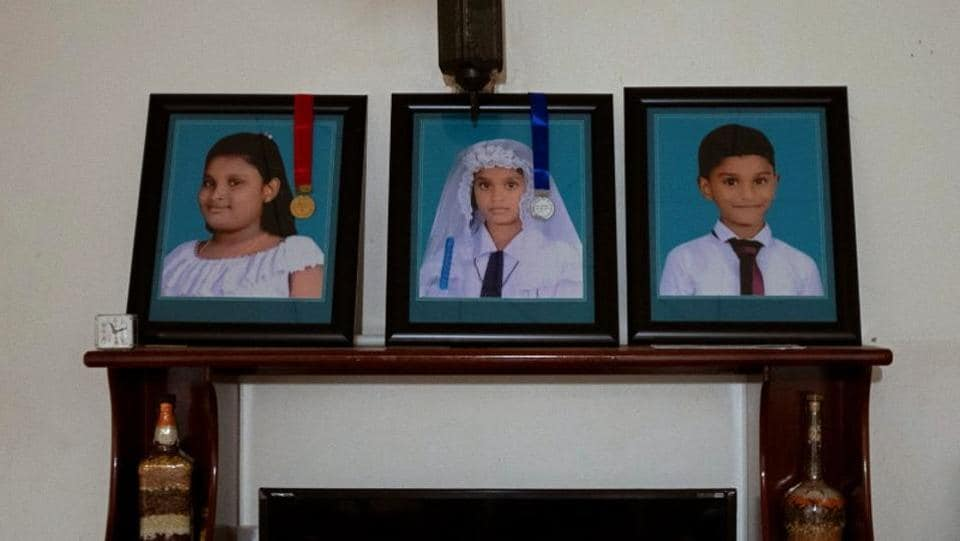 "Photos of Rashini, 13, her sister Shalomi, 10, and brother Shalom, seven, who were killed during Easter Sunday bombings, are seen inside their house. Pradeep Thusantha who lost his wife and children was outside the church. ""Me and my wife were deeply in love for the last 15 years. I worked hard to keep my family happy. Now I just have to leave this country and work for God for the rest of my life."" (Danish Siddiqui / REUTERS)"