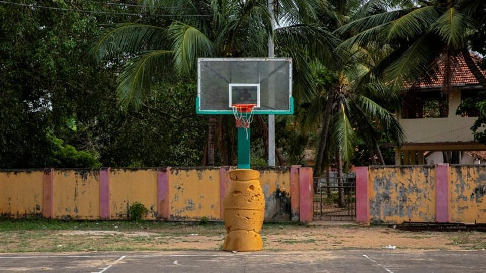 "An empty basketball court where Jackson, 13, used to play is seen in Batticalao. Jackson, a promising basketball player who was captain of his school team, died on the spot. ""He was my only child. I coached him to play basketball and we enjoyed playing together. Now my whole future generation is gone. Nothing is left,"" said his father, Arasaratnam Verl, as he looked at Jackson's jerseys and basketball. (Danish Siddiqui / REUTERS)"