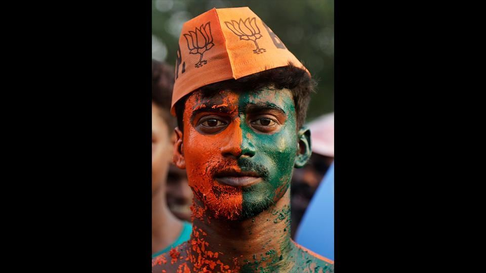 A supporter of India's ruling Bharatiya Janata Party (BJP) stands with his body painted as he attends an election rally. (Bikas Das / AP)