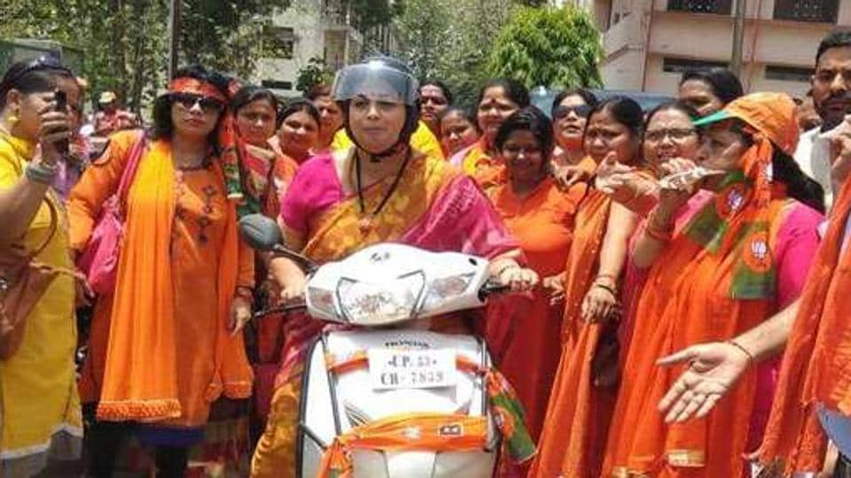 Union textiles minister Smriti Irani took part in a scooty rally to mobilise support for BJP candidate Ravi Kishan in Gorakhpur.