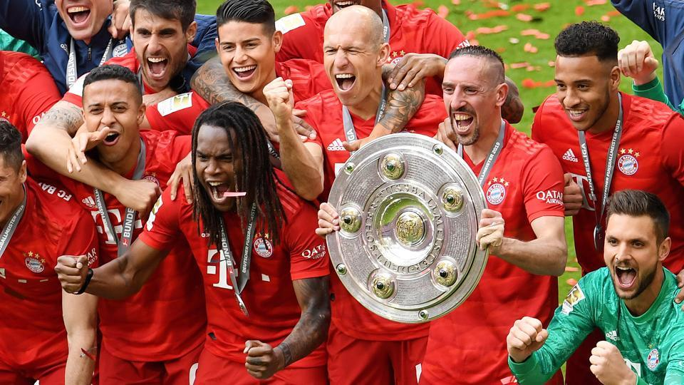 Bayern Munich's Franck Ribery, Arjen Robben and team mates celebrate with the trophy after winning the Bundesliga.