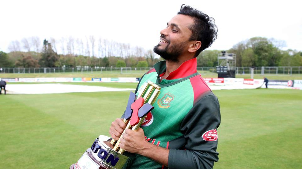 Bangladesh's captain Mashrafe Mortaza holds the winner's trophy.