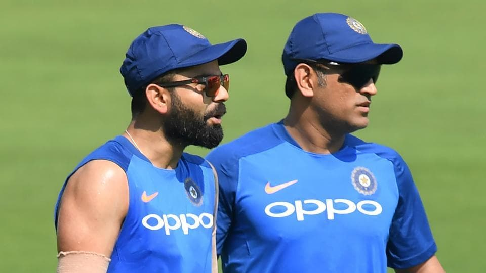 Indian cricket team's captain Virat Kohli (L) with Mahendra Singh Dhoni.
