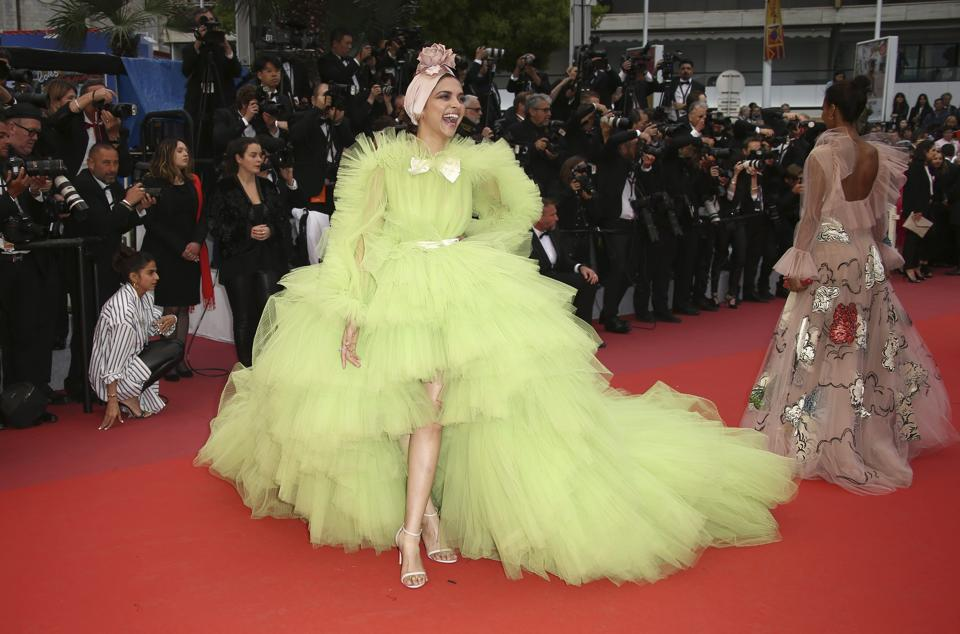 Deepika Padukone wows Cannes in a lime green dress, Ranveer Singh calls her 'nuts and un freaking real'. See pics