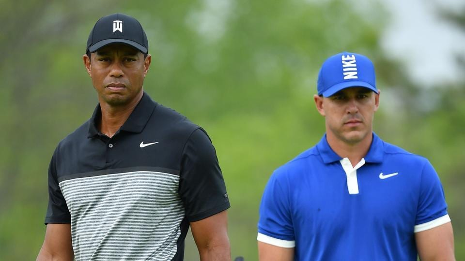 Tiger Woods and Brooks Koepka (R).