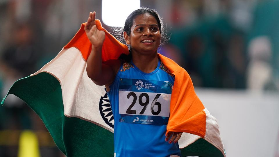 Silver medallist Dutee Chand of India poses on the podium during the awards ceremony for the Athletics Women's 100m final on day eight of the Asian Games on August 26, 2018 in Jakarta, Indonesia. (Photo by Lintao Zhang/Getty Images)