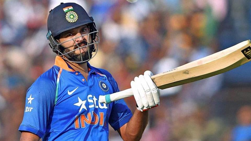 Cuttack: Indian batsman Yuvraj Singh reacts after completing his century during 2nd ODI Match against England at Barabati Stadium in Cuttack on Thursday.