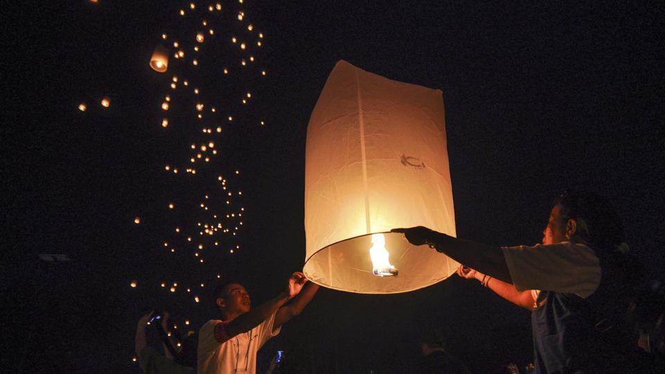 People fly sky lanterns during a celebration commemorating Vesak Day which marks the birth, death and enlightenment of Buddha,  in Magelang, Central Java province. Vesak Day is celebrated to pay a tribute to the contribution of Gautam Buddha. It was on the day of Vesak, in the year 623 B.C. when Buddha was born, attained enlightenment and it was on this day that Buddha in his 80th year passed away. (Slamet Riyadi / AP)