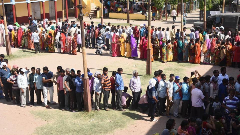 Voters stand in queues to cast their votes during the seventh and last phase of Lok Sabha elections, at Danapur, in Patna, Bihar. Today, polling is being held in 59 constituencies spread across seven states and one Union Territory, where over 10.01 crore voters are expected to decide the fate of 918 candidates. (Santosh Kumar / HTPhoto)