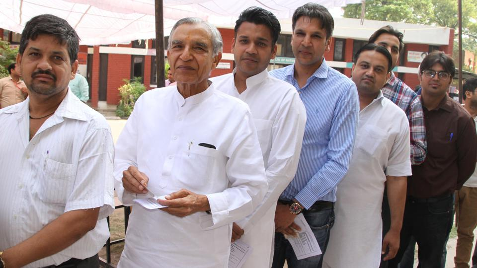 Congress candidate Pawan Kumar Bansal standing in a queue to cast his vote in Chandigarh on Sunday, May 19, 2019.