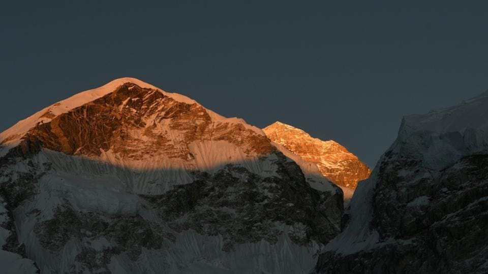 An Indian mountaineer was among 14 climbers who successfully scaled the world's highest peak Mount Everest on Monday, officials said.