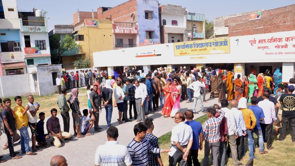 Voters stand in queues to cast their votes during the seventh and final phase of Lok Sabha elections, in Varanasi, Uttar Pradesh,  on Sunday, May 19, 2019.