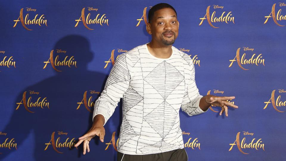 Actor Will Smith poses for photographers at the photo call for the film Aladdin in London.