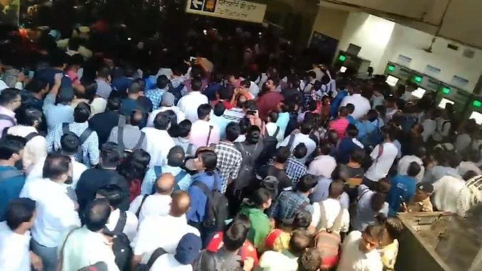Photographs and video tweeted by passengers show the metro stuck on tracks and people deboarding and walking on the tracks.