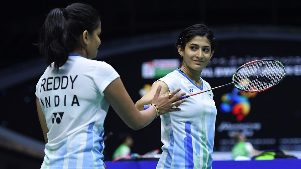 Ashwini Ponnappa (R) and N.Sikki Reddy react after winning a point against Chow Mei Kuan and Lee Meng Yean.