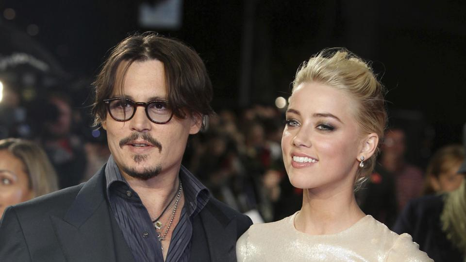 Johnny Depp, left, and Amber Heard arrive for the European premiere of their film, The Rum Diary.