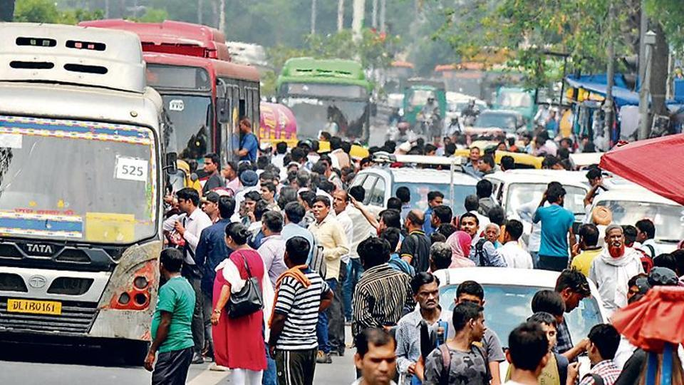 People crowd onto public transport after metro service operations on the Yellow Line were hit at around 9:30 am due to the breakdown of overhead wires between Sultanpur station and Chattarpur Metro station,
