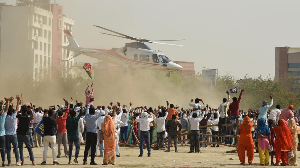 Three days before the elections kicked off on April 11, supporters of Bahujan Samaj Party (BSP) were elated at the sight of a helicopter carrying party supremo Mayawati arriving for an election rally in Greater Noida, Uttar Pradesh. While Mayawati herself did not contest the elections this time, she did address a number of public rallies in support of her party's candidates. (Virendra Singh Gosain / HT Photo)