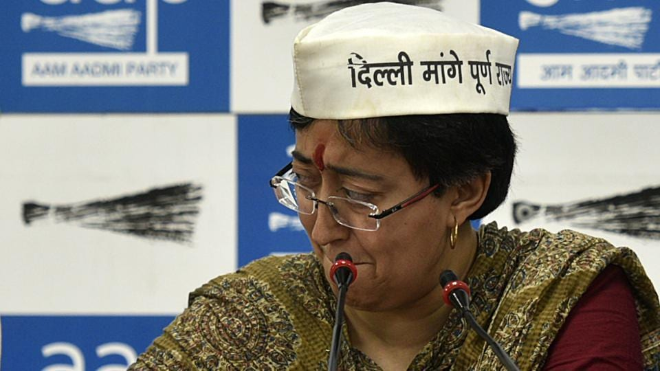 During the run-up to the sixth phase of the polls in Delhi, Aam Aadmi Party (AAP) East Delhi candidate Atishi Marlena broke down while reading a derogatory pamphlet allegedly distributed by the Bharatiya Janata Party's (BJP) candidate Gautam Gambhir against her, during a press conference at the AAP party office in New Delhi. (Biplov Bhuyan / HT Photo)