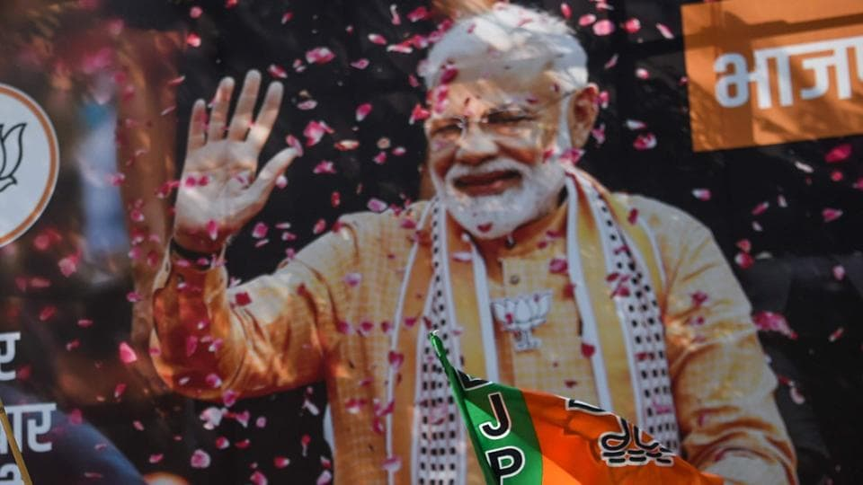 A poster of Indian Prime Minister Narendra Modi in Mumbai as BJP supporters celebrate on the election results day outside the BJP headquarters in Mumbai on May 23, 2019.