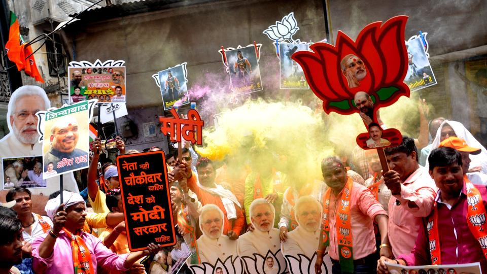 BJP workers celebrate the party's lead on the counting day of 2019 Lok Sabha elections, Varanasi, May 23, 2019