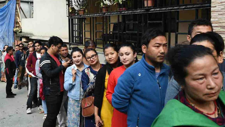Voters standing in a queue to cast their votes, at a polling booth, during at Gangtok, Sikkim on  April 11, 2019. The state is also electing a new assembly.