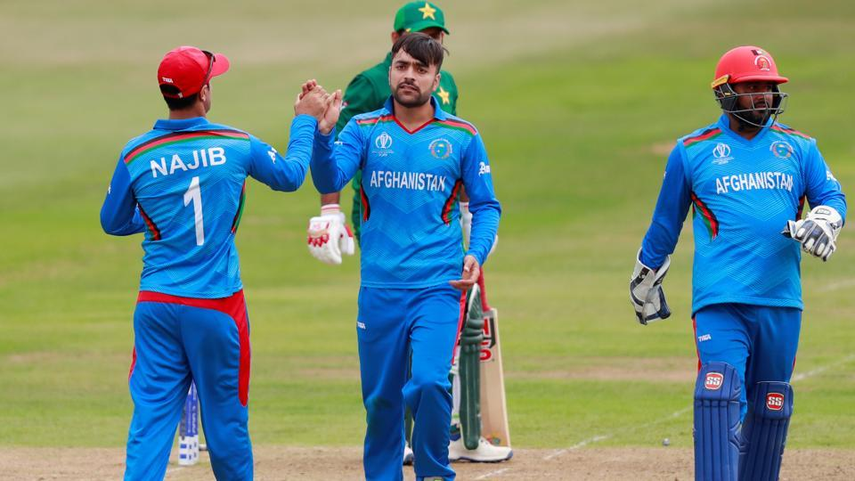 Afghanistan's Rashid Khan celebrates with Najibullah Zadran after taking the wicket of Pakistan's Sarfaraz Ahmed. (Action Images via Reuters)
