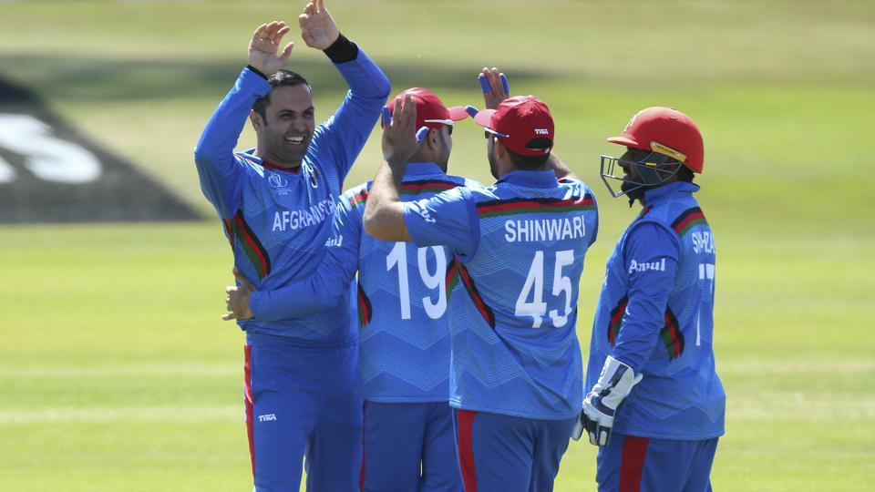 Afghanistan's Mohammad Nabi, left, celebrates after taking the wicket of Pakistan's Haris Sohail. (AP)