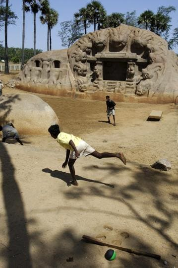 Boys playing in front of a cave near Mamallapuram in Tamil Nadu.