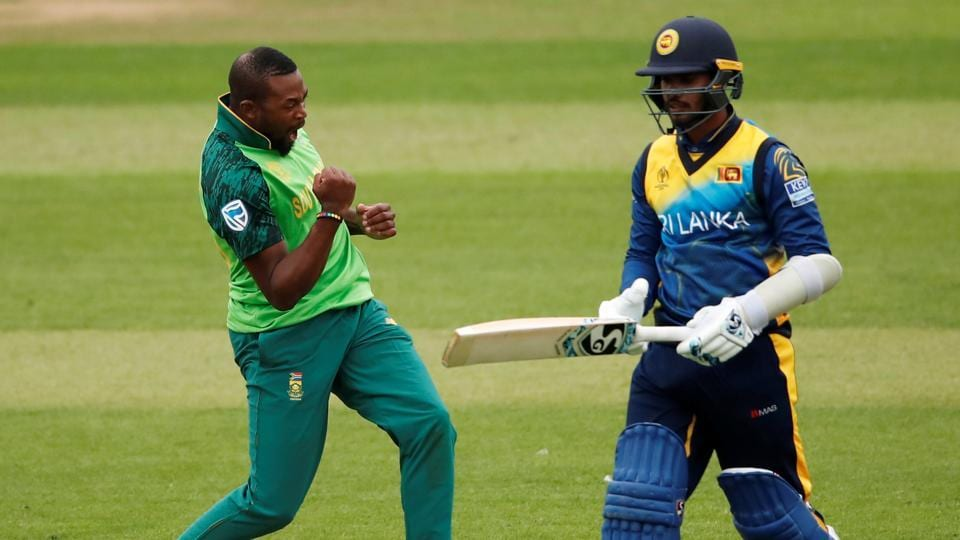 South Africa's Andile Phehlukwayo celebrates taking the wicket of Sri Lanka's Dhananjaya de Silva during their ICC World Cup warm-up match. (Reuters)