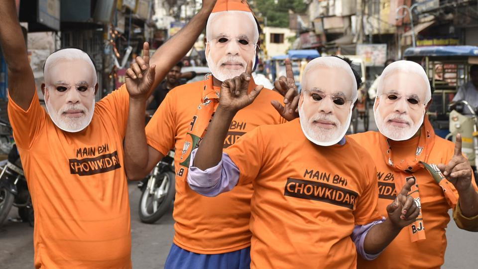 Bharatiya Janata Party (BJP) workers seen wearing Prime Minister Narendra Modi masks and 'Chowkidaar' T-shirts as National Democratic Alliance (NDA) takes lead in the Lok Sabha election results, in Amritsar, Punjab, India, on Thursday, May 23, 2019.