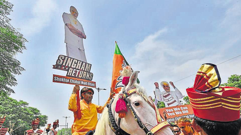 Bharatiya Janta Party (BJP) supporters celebrate the party's victory in the Lok Sabha Elections, at party headquarters, in New Delhi, India, on Thursday.